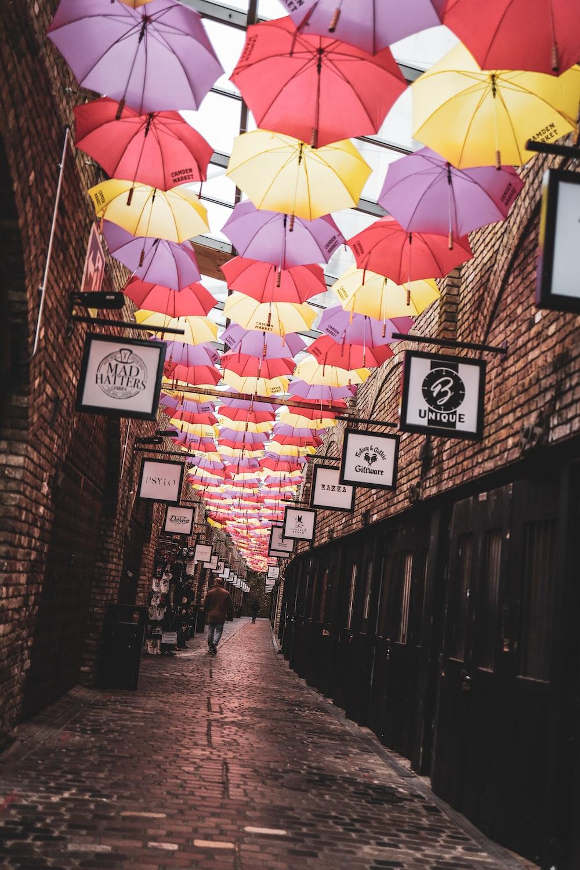 umbrella hanging on wall during daytime