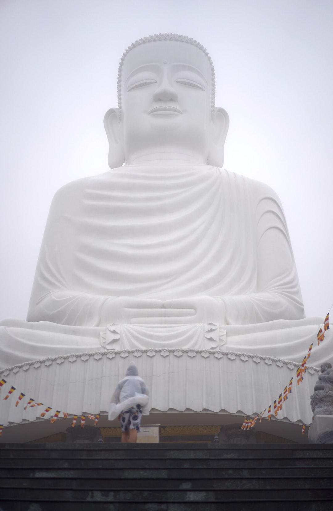 Buddha statue in the mist. Bana Hills, Vietnam.