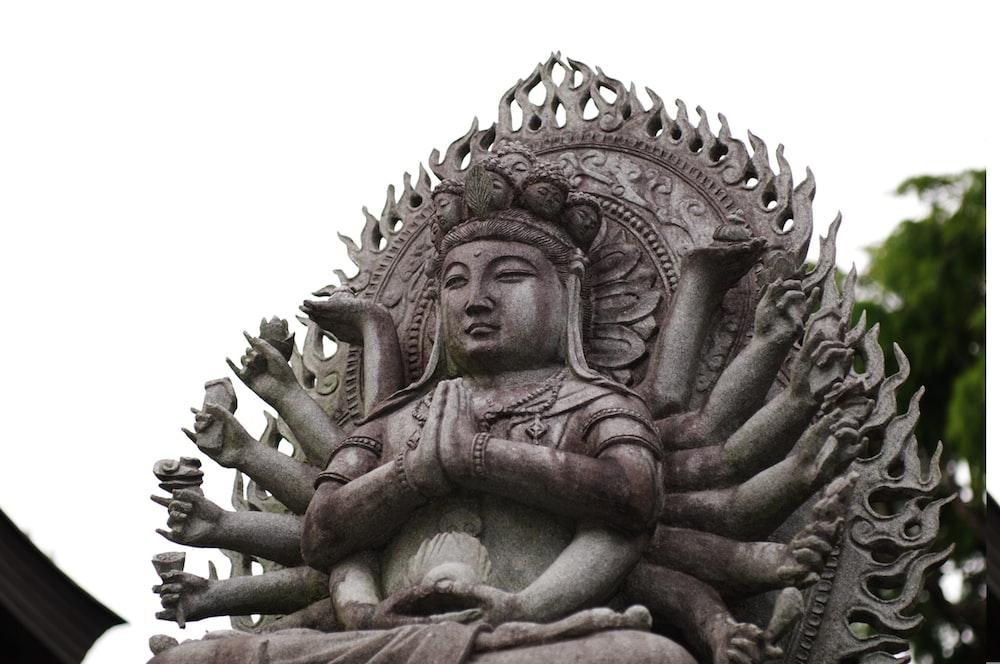 brown concrete dragon statue during daytime