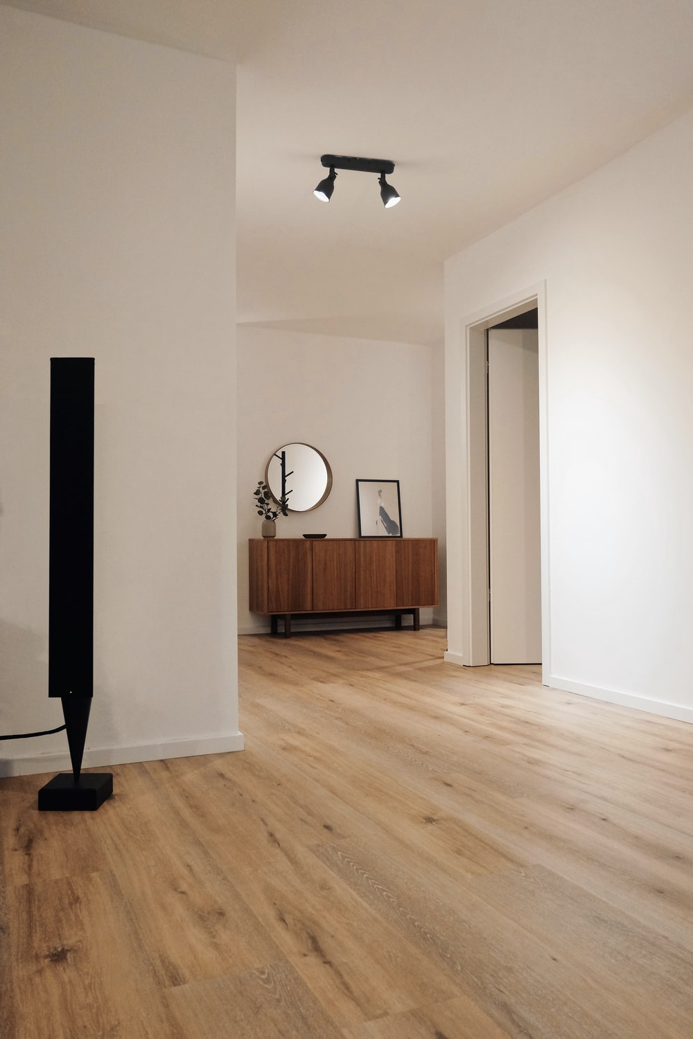 black tower speaker beside white wall