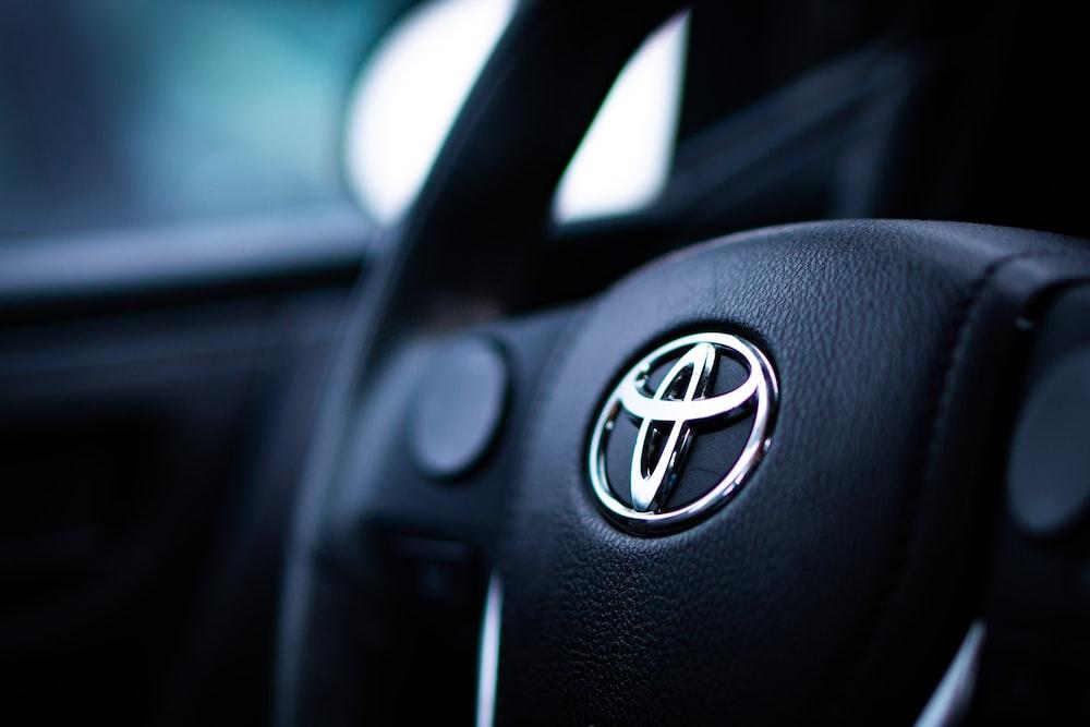 black toyota car steering wheel