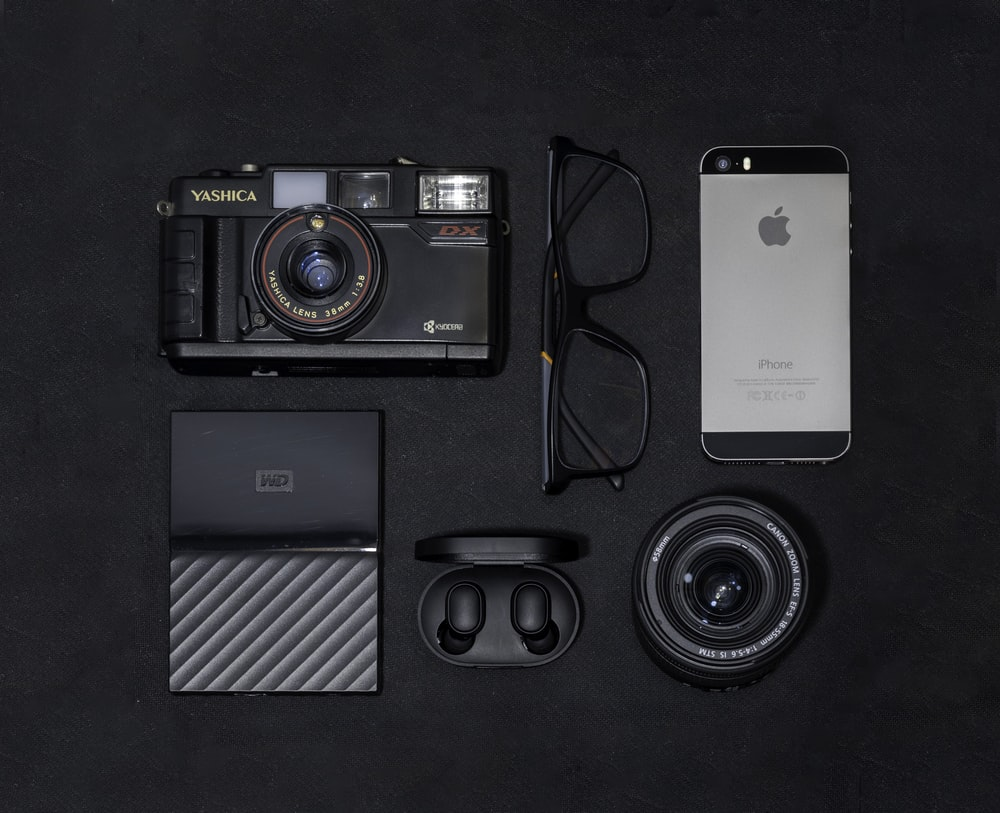 silver iphone 6 beside black and gray camera