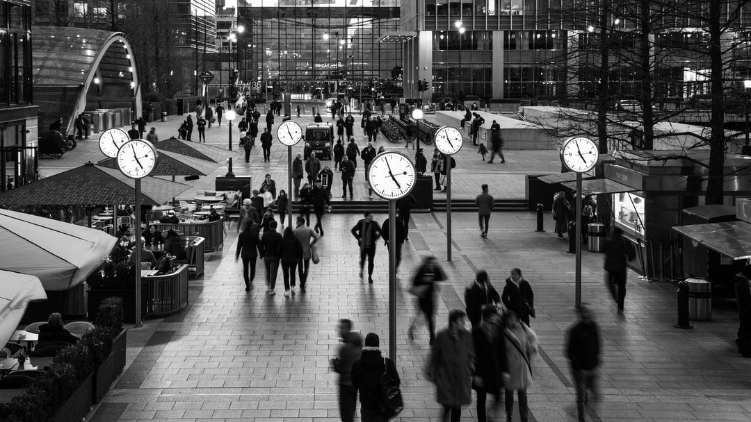 A busy Saturday evening at Canary Wharf main square in East London. The clocks are an obvious photographer's favourite.
