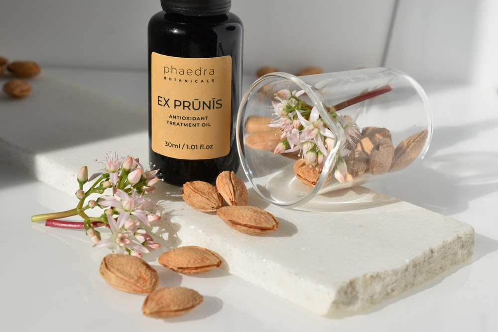 brown almond butter on white table