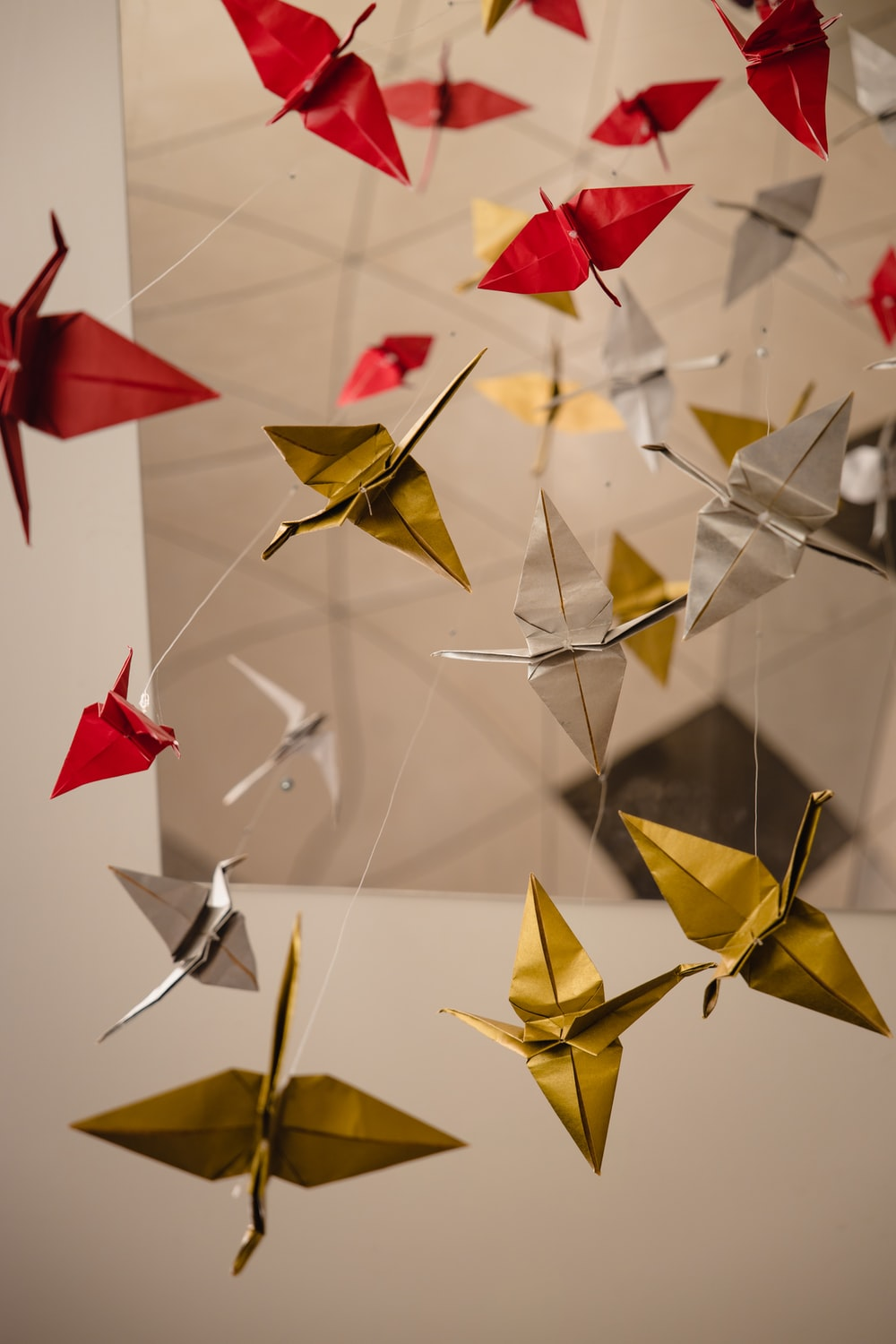 yellow and red paper boats