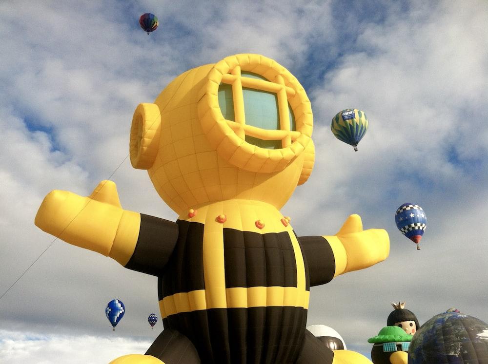 yellow and black hot air balloon