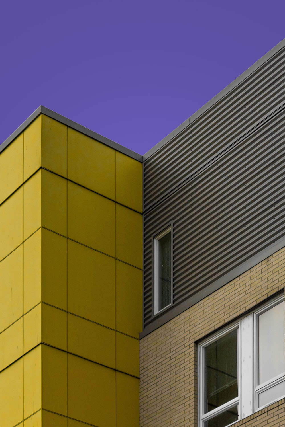 yellow concrete building under blue sky during daytime