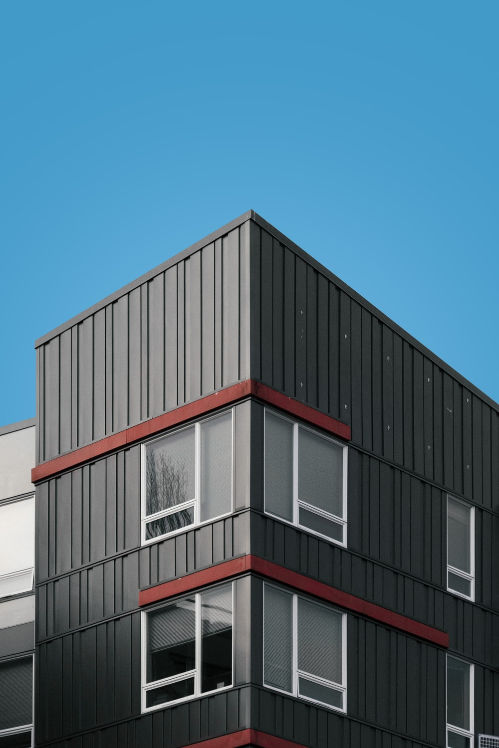 white and red concrete building under blue sky during daytime