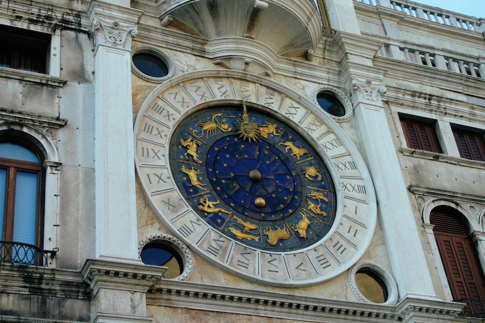 brown and black analog clock