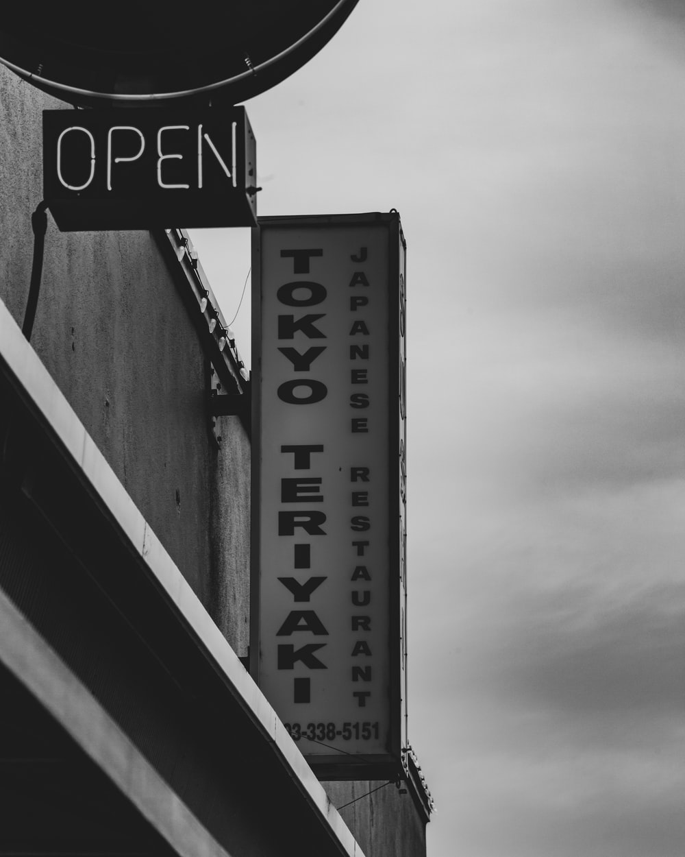 grayscale photo of UNK signage