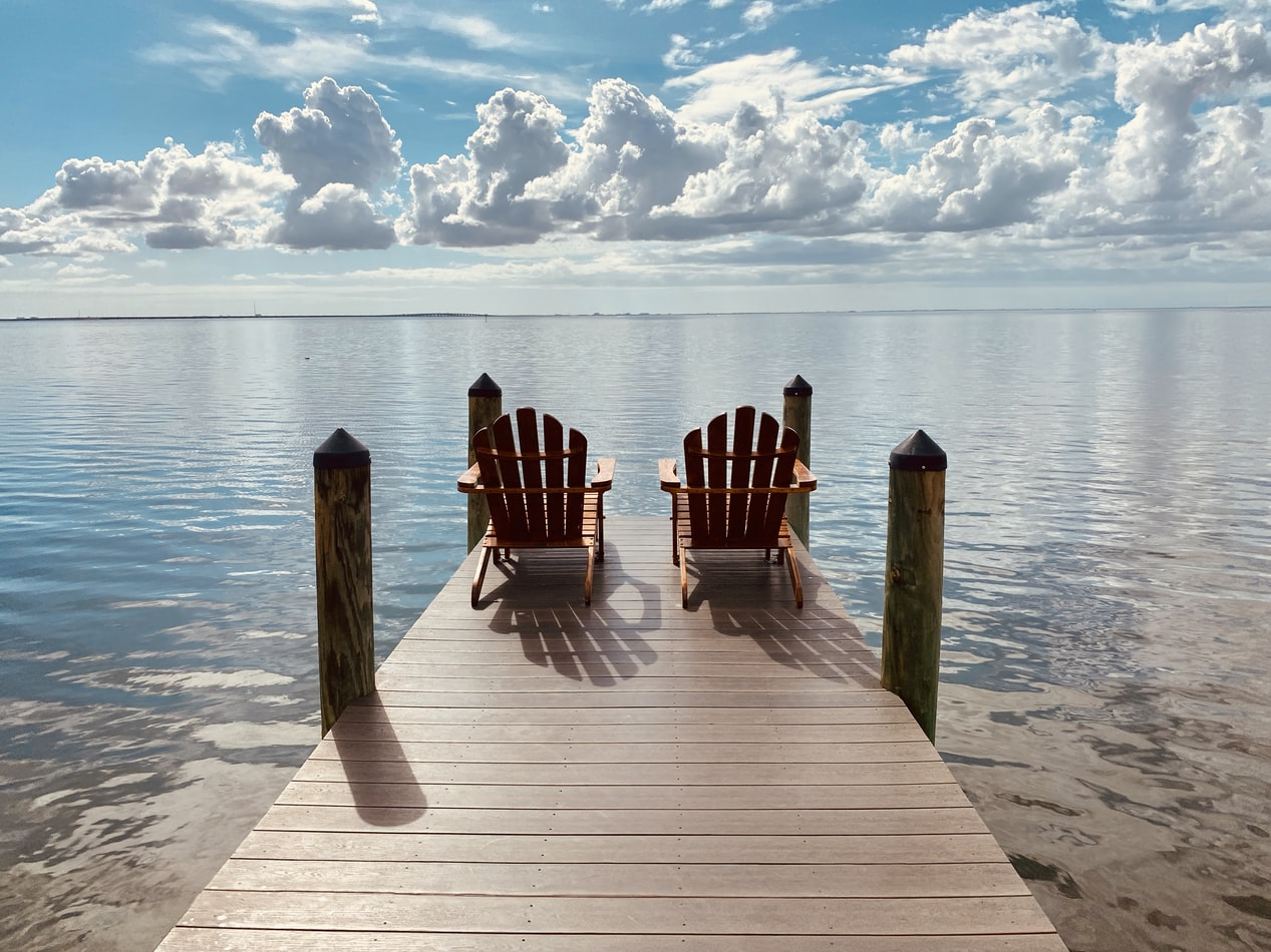 two chairs sitting on a dock over the water in Tampa, FL