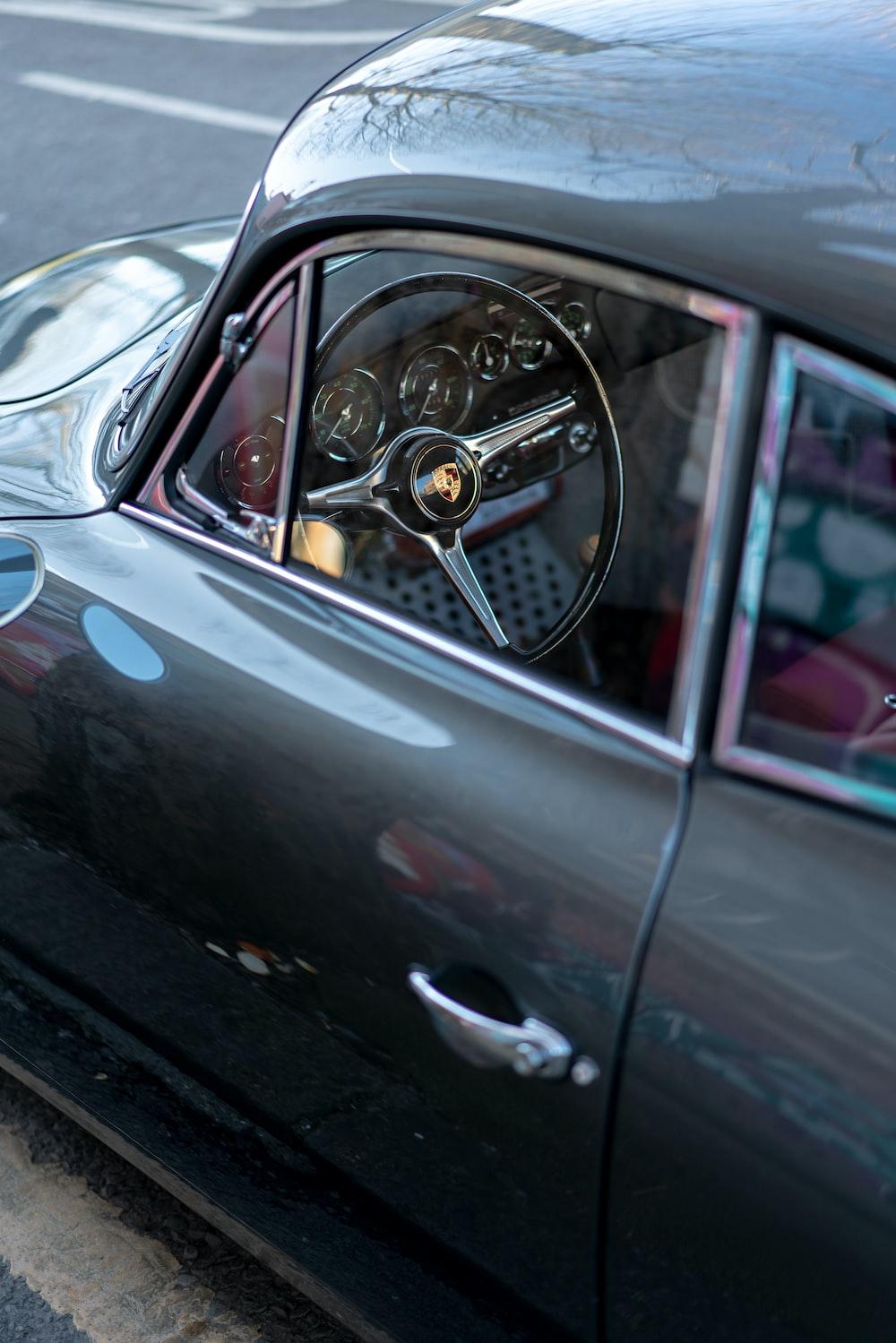 black car with silver steering wheel
