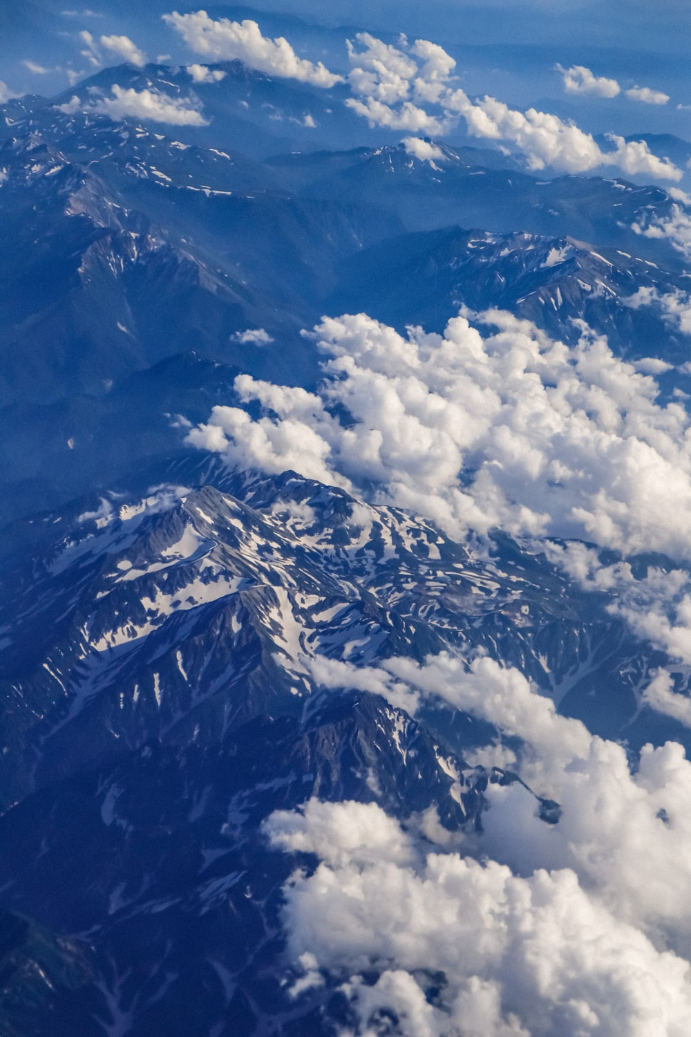 aerial view of snow covered mountain during daytime