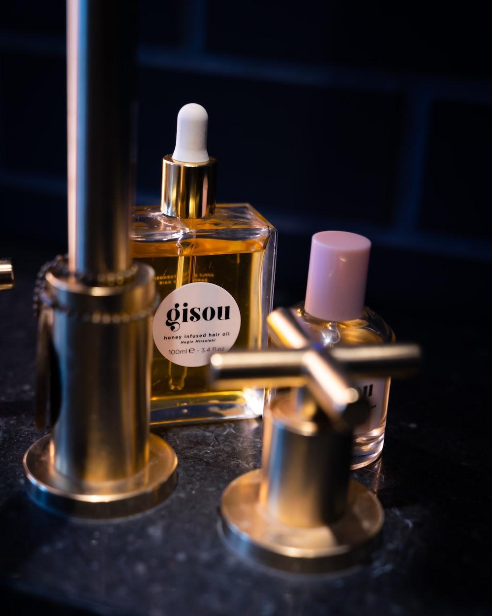 two perfume bottles on black table