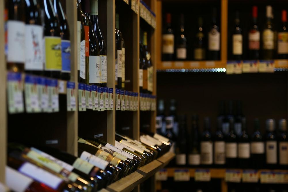bottles on brown wooden shelf