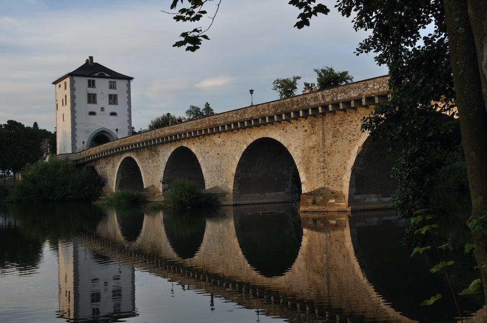 brown concrete bridge over river