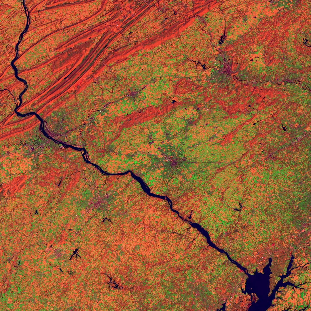 The Susquehanna River appears as a dark line coursing through this scene in southeastern Pennsylvania. The cities of York, Lancaster, and Reading lie among agricultural lands. The State capital, Harrisburg, is positioned against the orange folds in the upper left of the image, along the edge of the Appalachian Mountain Ridge and Valley Province.