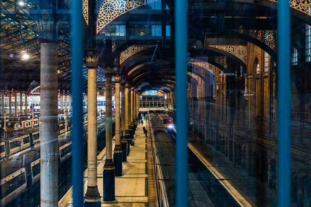 London, UK - Liverpool Street Train Station. Victorian design with modern rail now, from a window outside looking in through the bars.