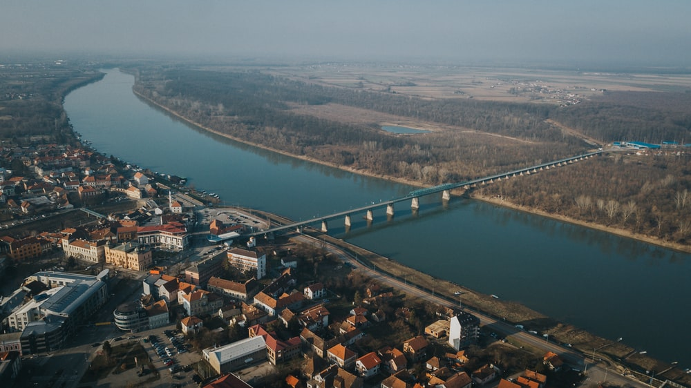 aerial view of city near body of water during daytime