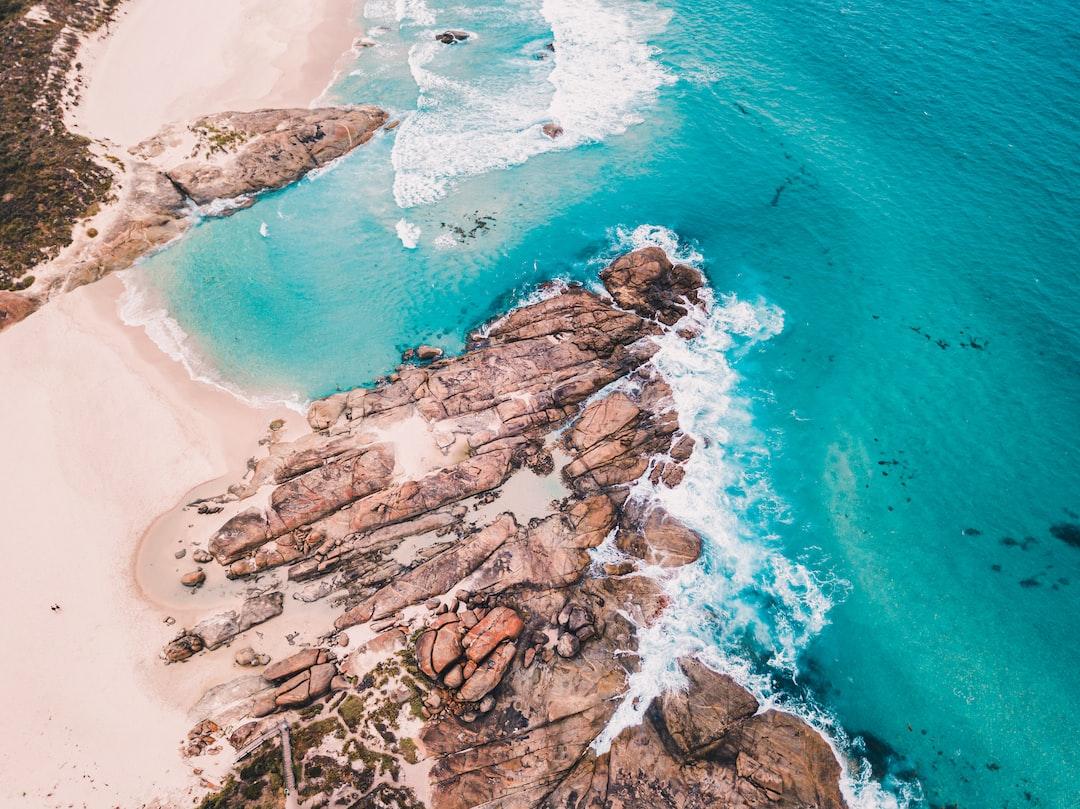 Brown Rock Formation On Blue Sea Water During Daytime - unsplash