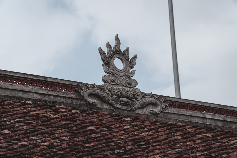 grey dragon statue on roof