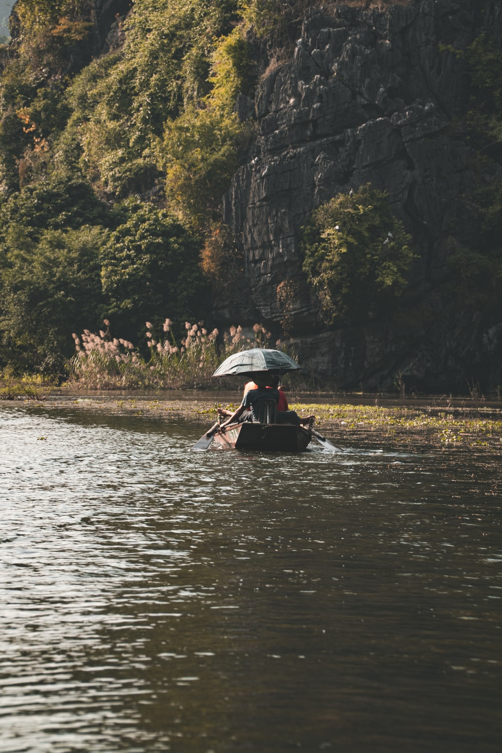 person riding on boat on river during daytime
