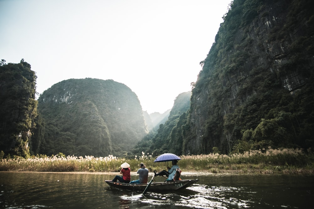 2 person riding on boat on river during daytime