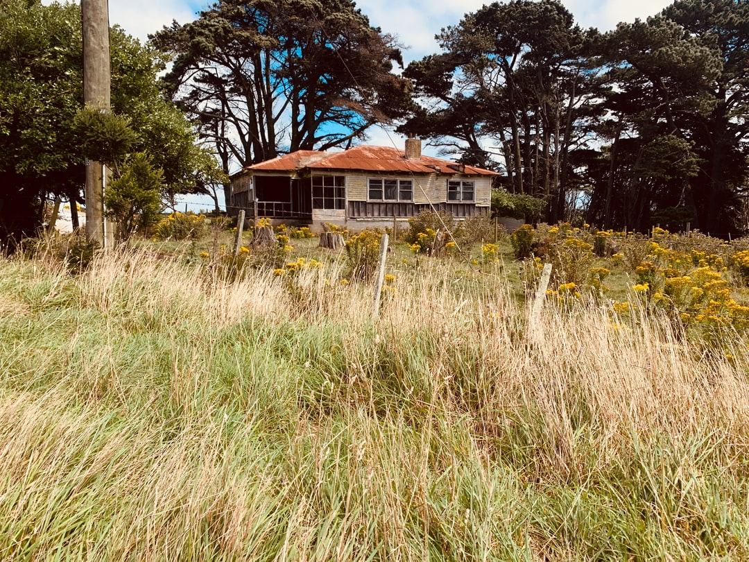 Rusted out abandoned house. Neglected for decades but shockingly picturesque as I ran through the wilderness. This house is isolated and one would say hasn't been lived in since the 70's when the area was a mining town. King Island, Tasmania.