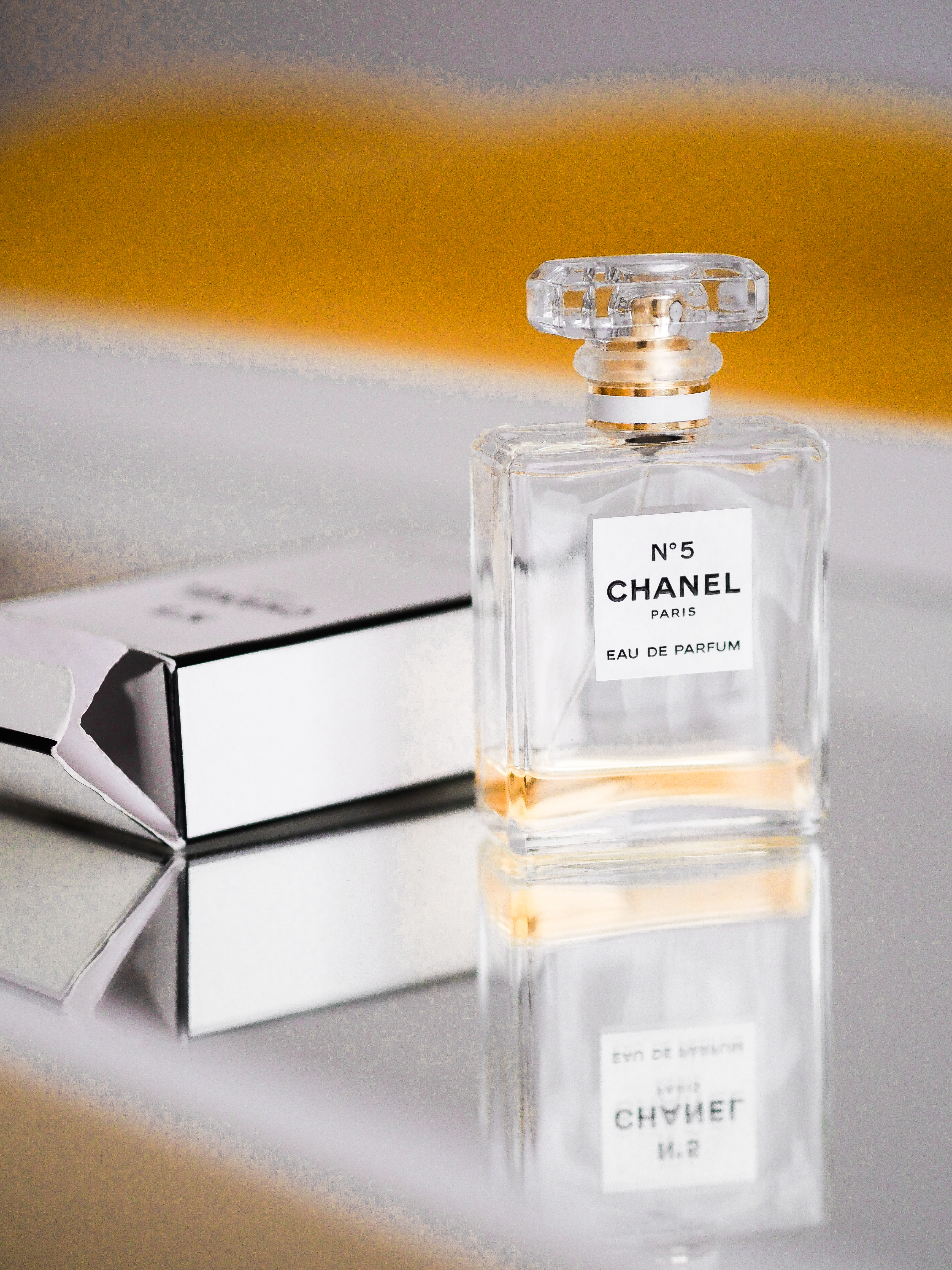 clear glass perfume bottle with box