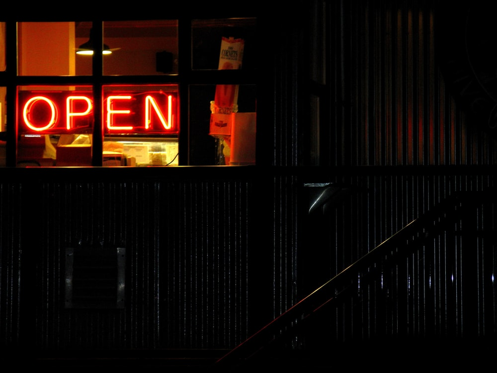 red and black open neon light signage
