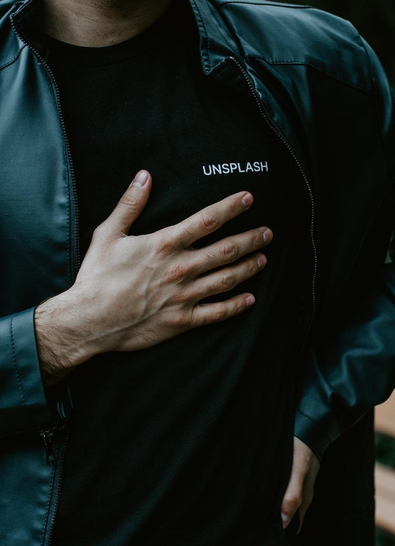 man in black adidas zip up jacket