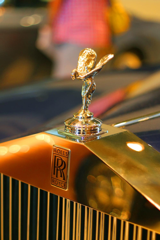 gold and black car hood ornament