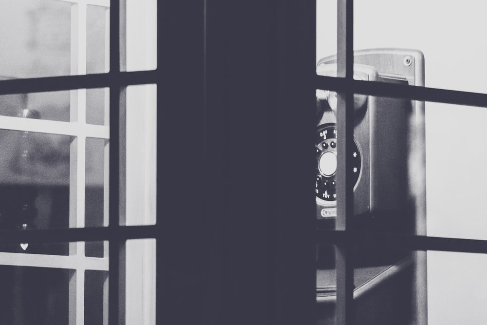 black and silver speaker beside window