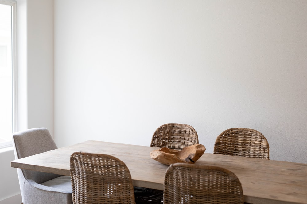 brown woven chair beside white table