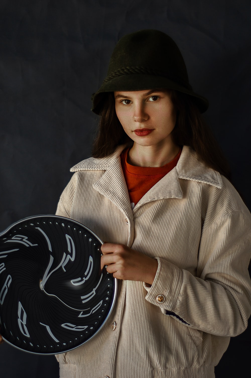 woman in black hat and brown coat