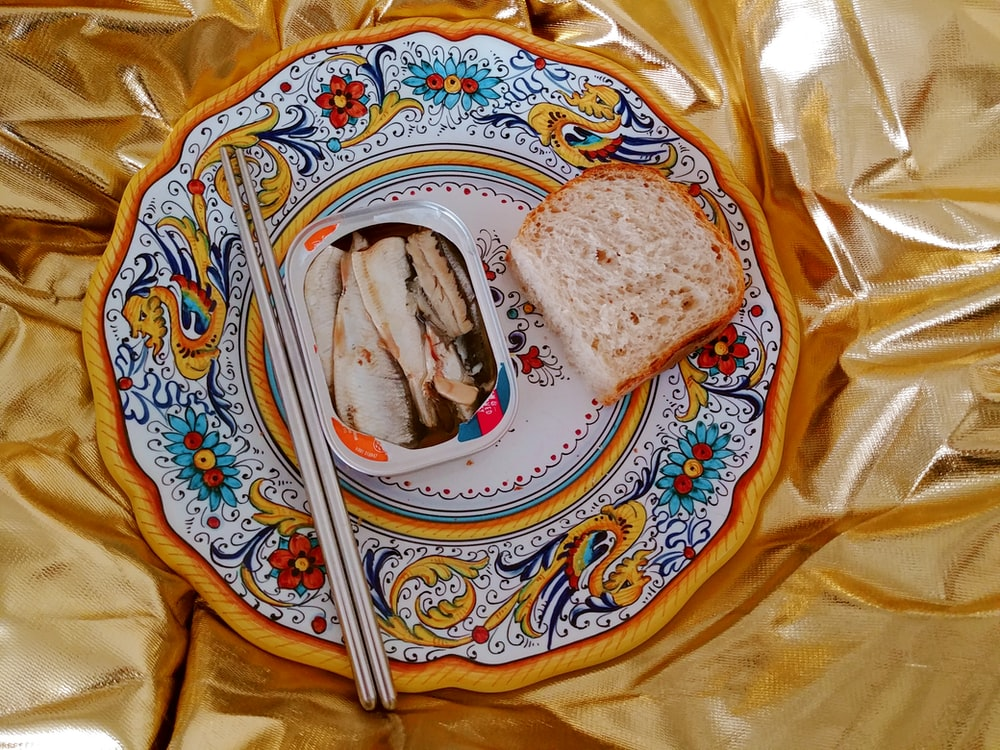 bread on white and blue floral ceramic plate