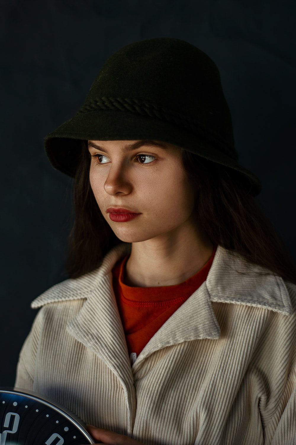 woman in black hat and white coat