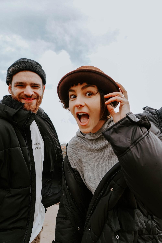 man in black jacket beside woman in black jacket