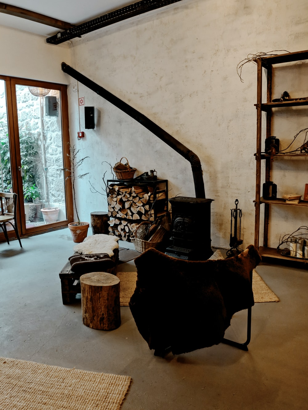 black metal fireplace near brown wooden shelf