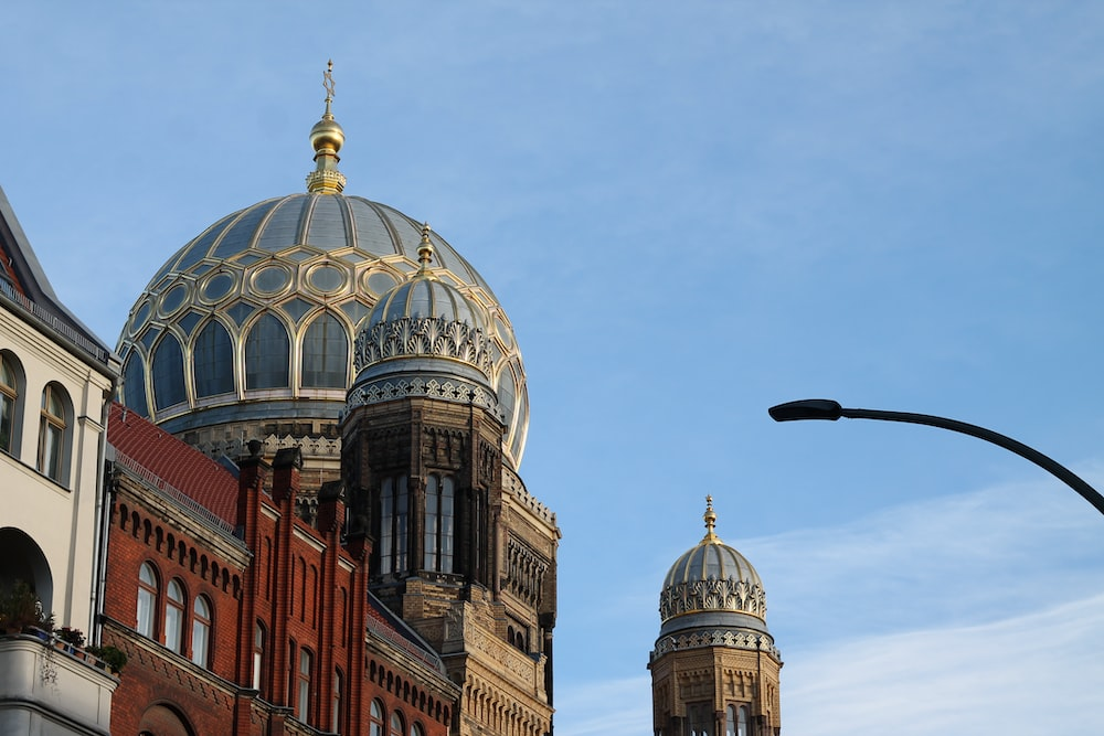 brown and white dome building under blue sky during daytime