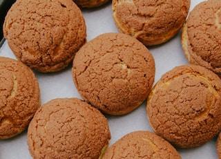 three brown cookies on white ceramic plate