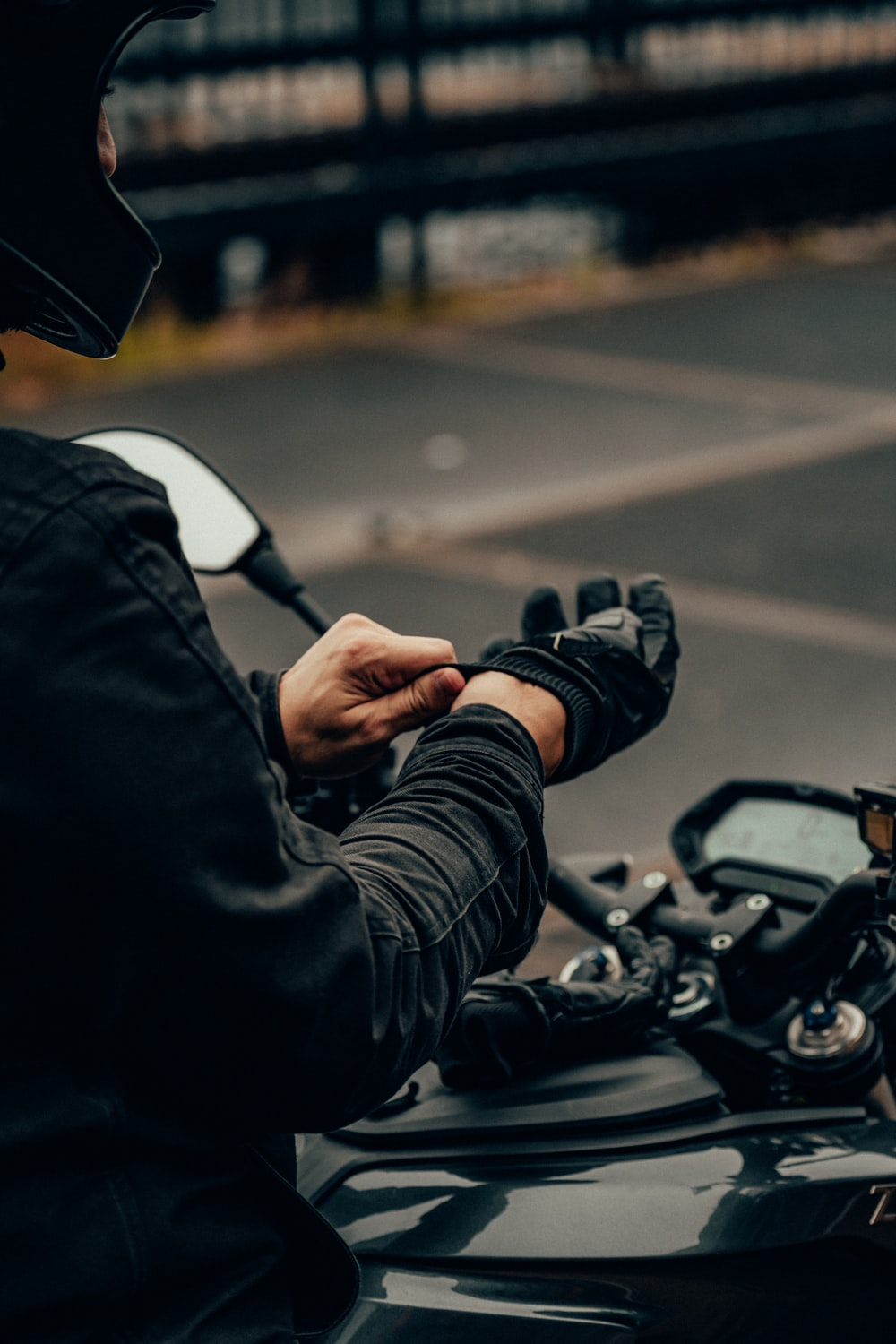 person in black jacket driving motorcycle