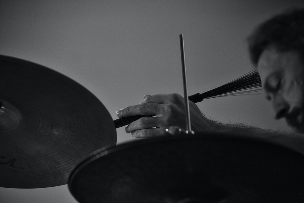person holding a black and white drum stick
