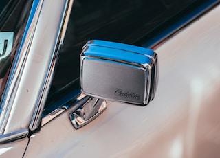 blue and silver car door handle