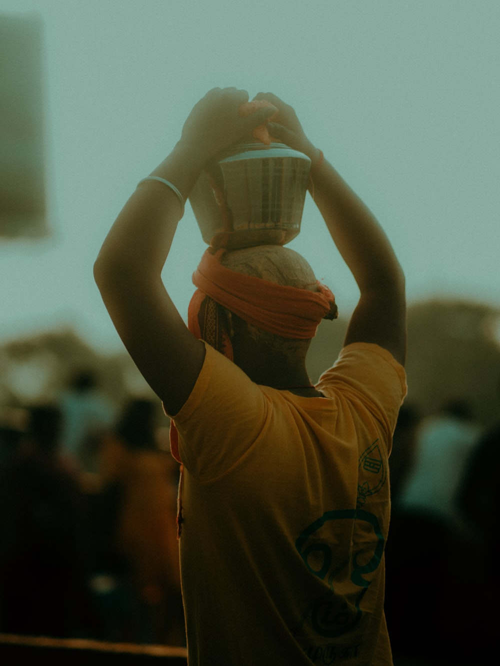 woman in yellow t-shirt holding white ceramic cup