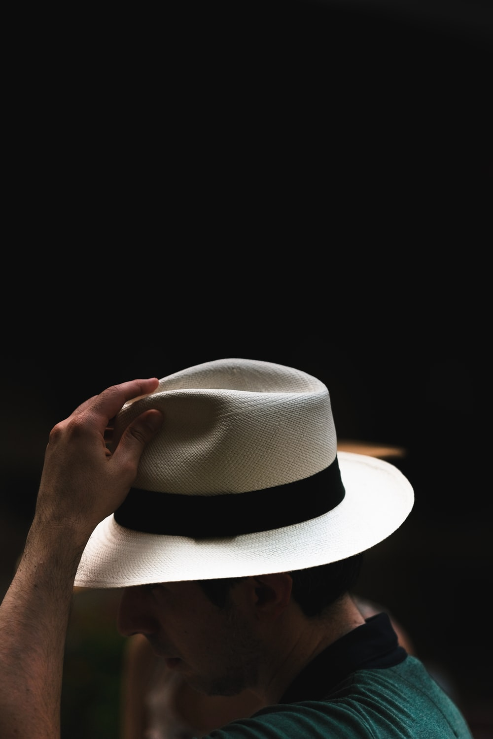 person wearing white fedora hat