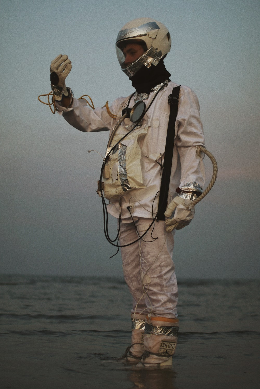 man in brown pants holding rope