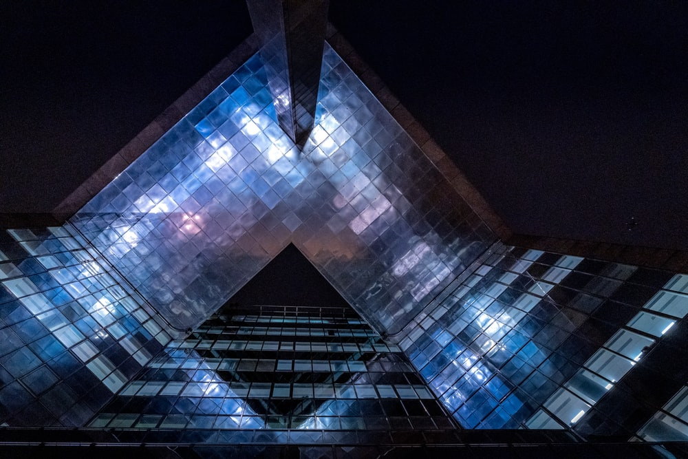 blue and black glass building during night time