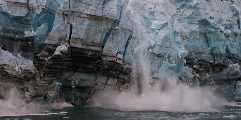 water splash on brown rock formation during daytime