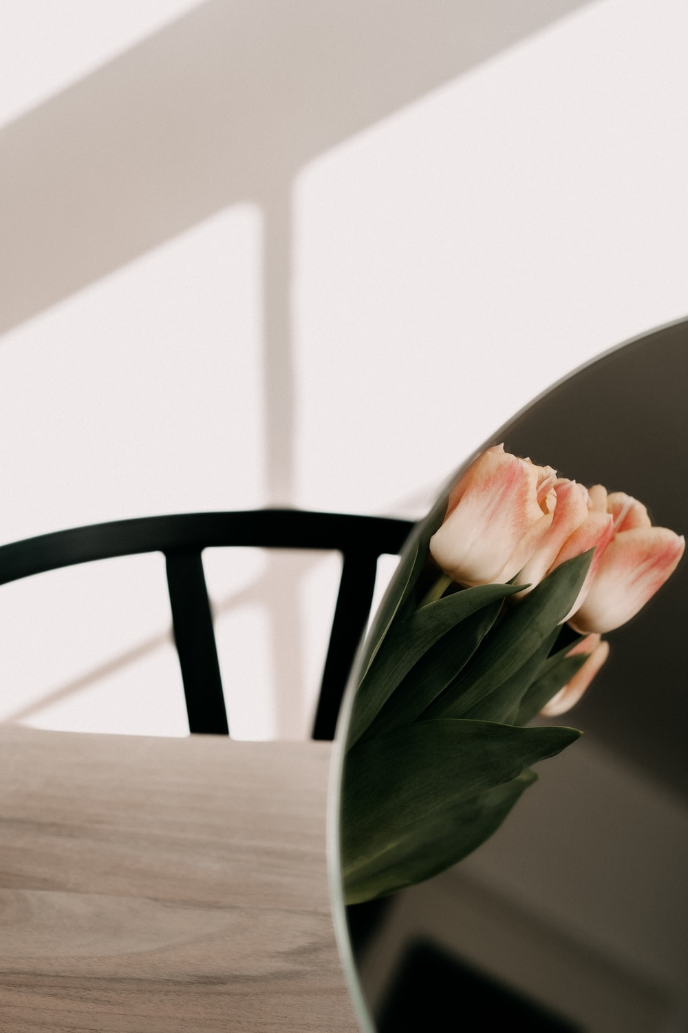 pink flower on brown wooden table